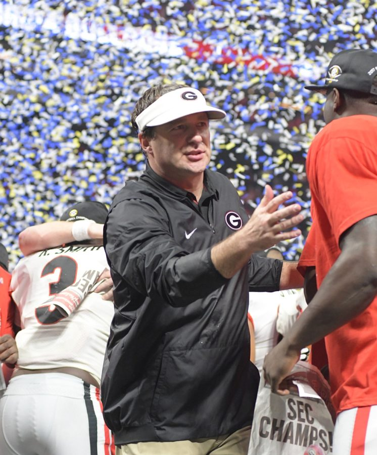 Kirby Smart celebrates the SEC Championship with his Bulldogs