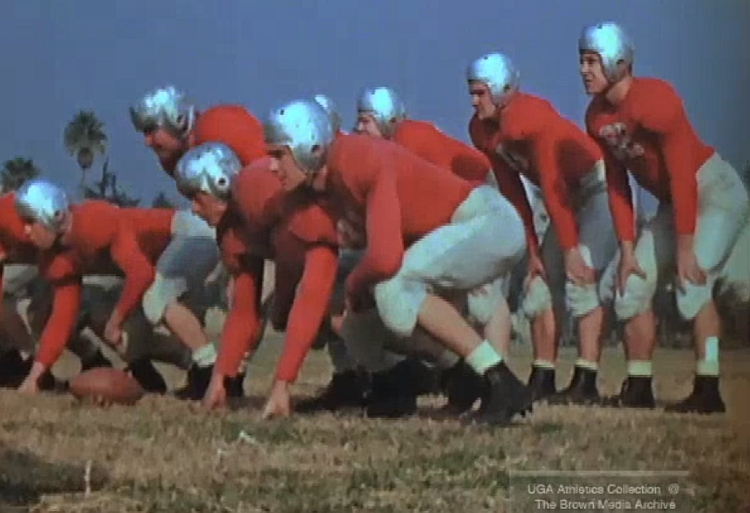 1942 UGA football team gets in some practice and time in front of the press at the 1943 Rose Bowl, (photo from footage of the 1943 Rose Bowl from UGA Athletics Collection: The Brown Media Archive)