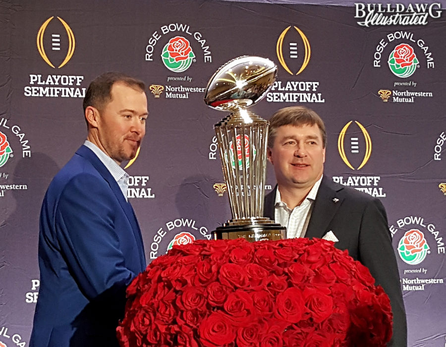 Oklahoma's Lincoln Riley and Georgia's Kirby Smart pose with the Rose Bowl Trophy on Sunday, Dec. 31, 2017.