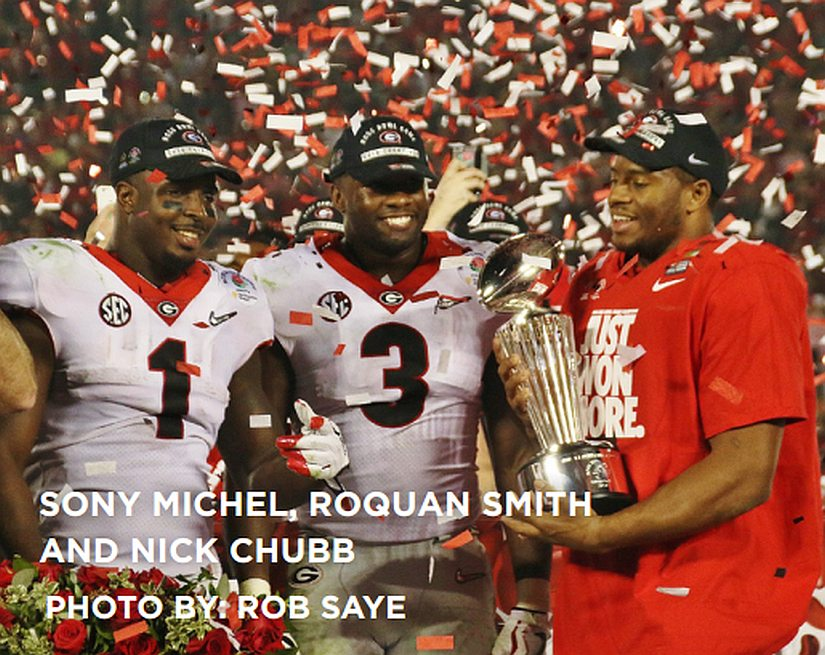 Sony Michel (1), Roquan Smith (3), and Nick Chubb celebrating the 54-48 win with the Rose bowl College Football Playoff trophy (Photo by Rob Saye)