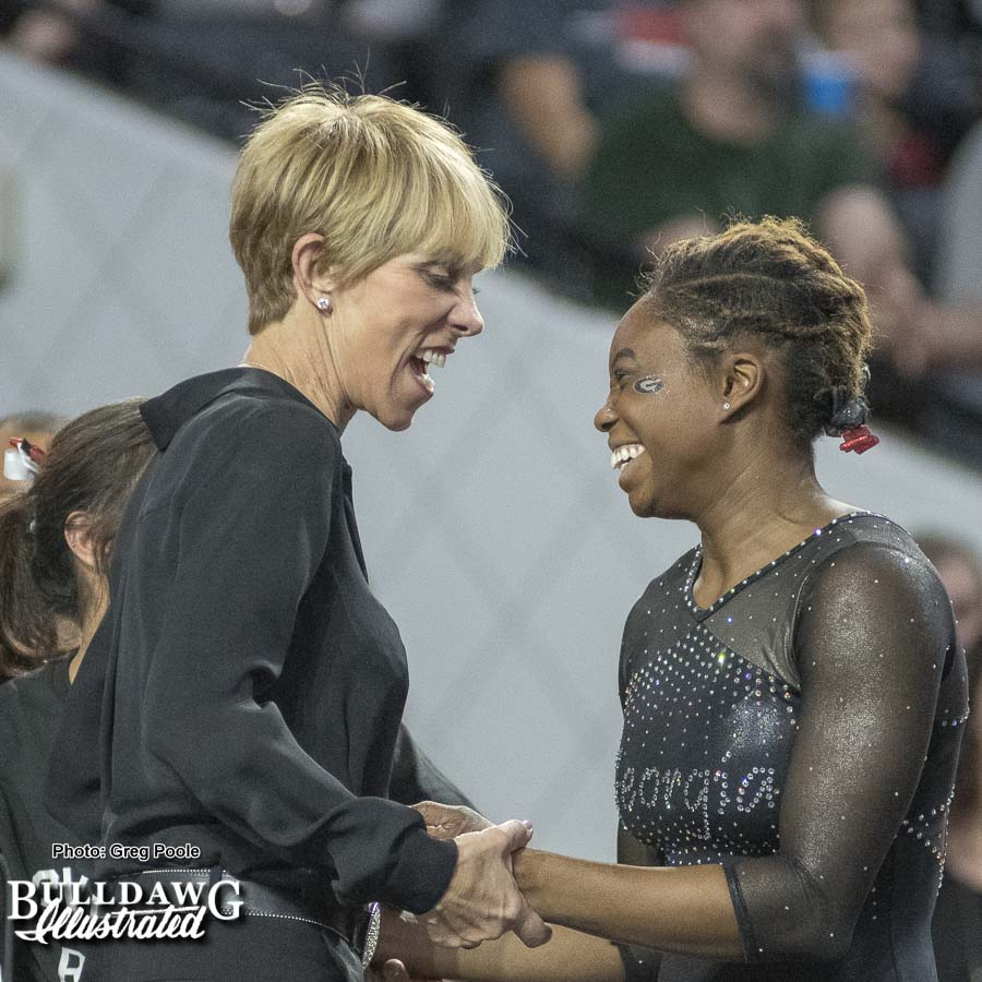 Suzanne Yoculan Leebern congratulates Jasmine Arnold after floor routine – Georgia vs. Oklahoma – January 15, 2018