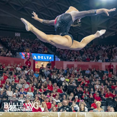 Sabrina Vega with magnificent leap on beam.