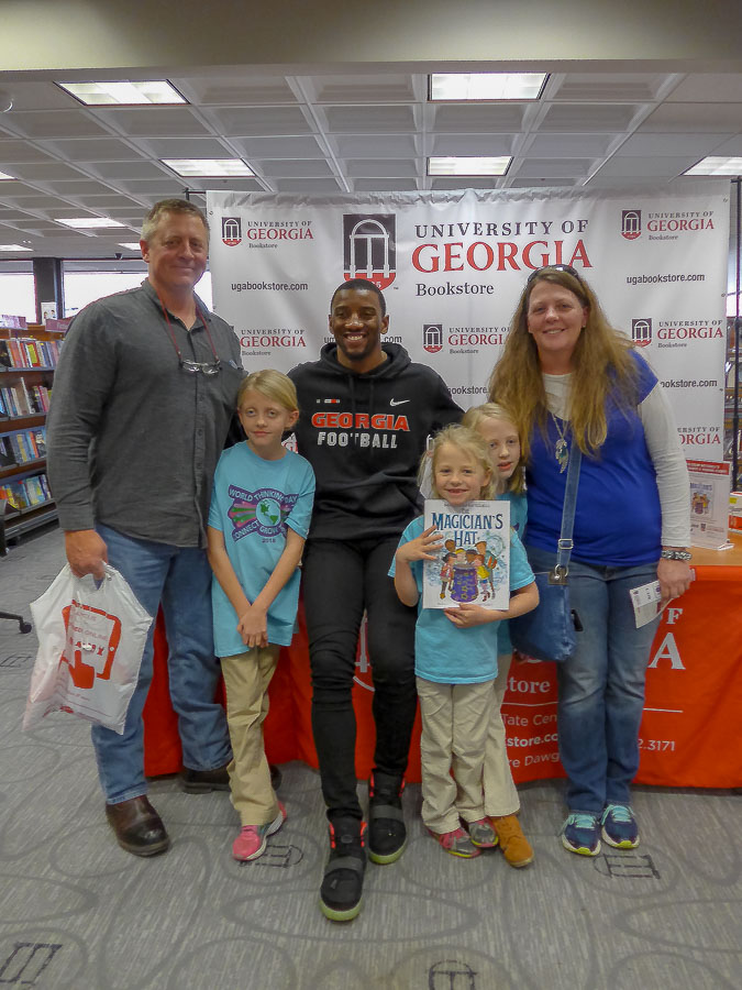 Olivia, Annabella, Sophia, Jennifer and Heath McGregor with Malcolm Mitchell