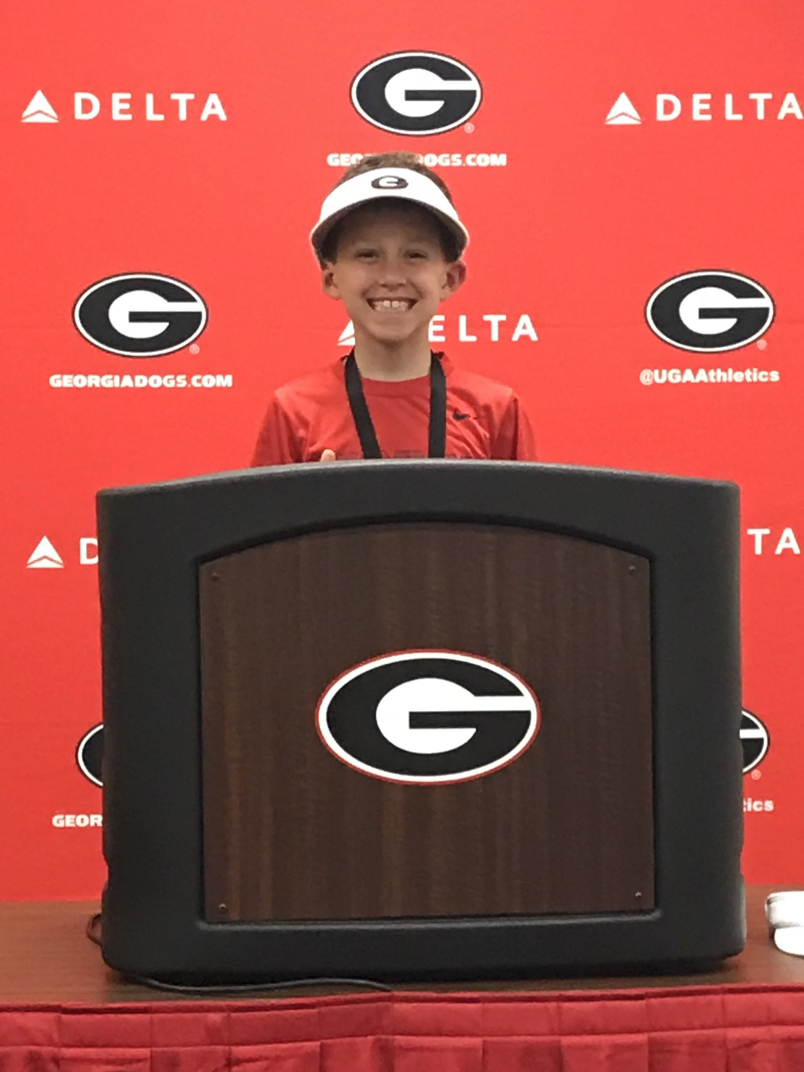 Jim Coleman (9) - Wide Receiver - At the podium, where Coach Smart gives his post game interviews, even wearing the visor to mimic Coach.