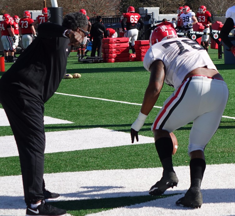 Coach Rocker encourages Trent Thompson during fumble drill