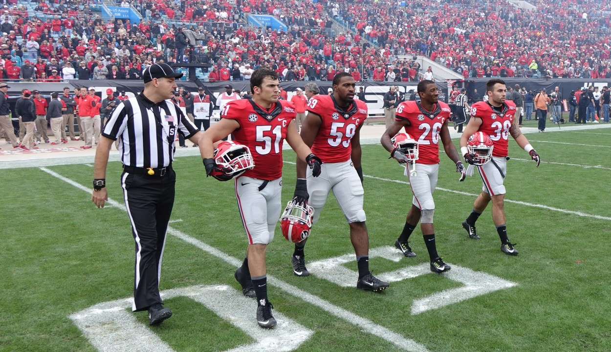 TaxSlayer Bowl  opening ceremonies and coin toss 02-JAN-2016 (Left to right) No.51 Jake Ganus, No. 59 Jordan Jenkins, No.26 Malcolm Mitchell, and No.38 Ryne Rankin (Photo by Greg Poole)