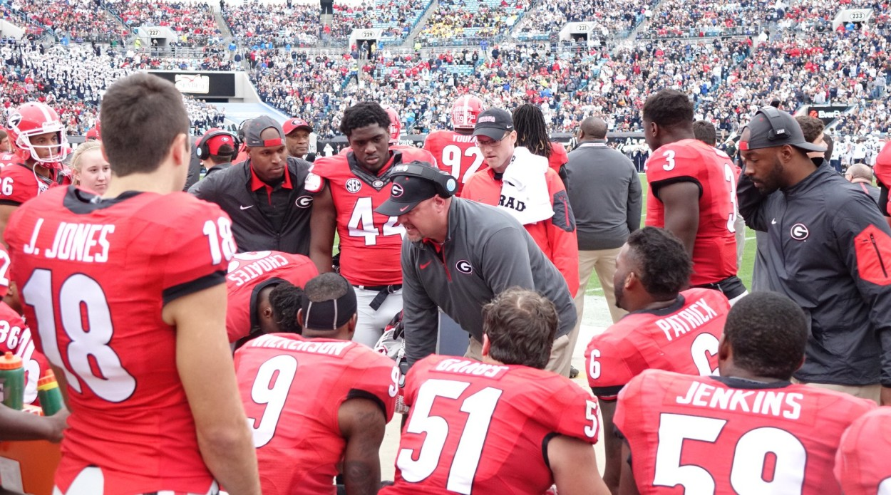 Georgia Defensive Coach Kevin Sherrer talks with defense after they get a stop - first half TaxSlayer Bowl 02-JAN-2016 (Photo by Greg Poole)
