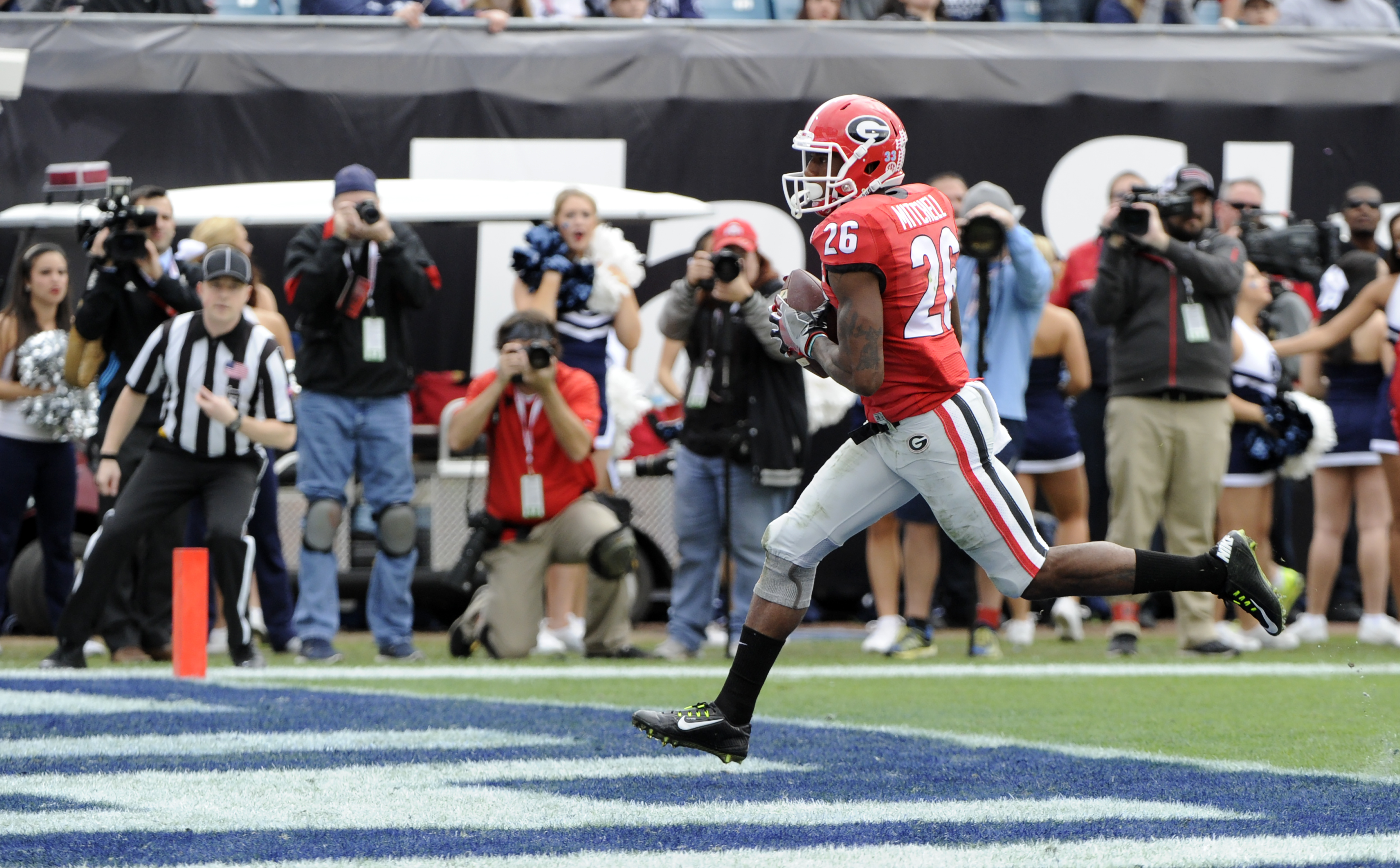 Georgia receiver Malcolm Mitchell (26) scores a touchdown during the Bulldogs' game against the Penn State Nittany Lions in the TaxSlayer Bowl on Saturday, Jan. 2, 2016 at EverBank Field in Jacksonville, Florida (Photo by John Kelley)