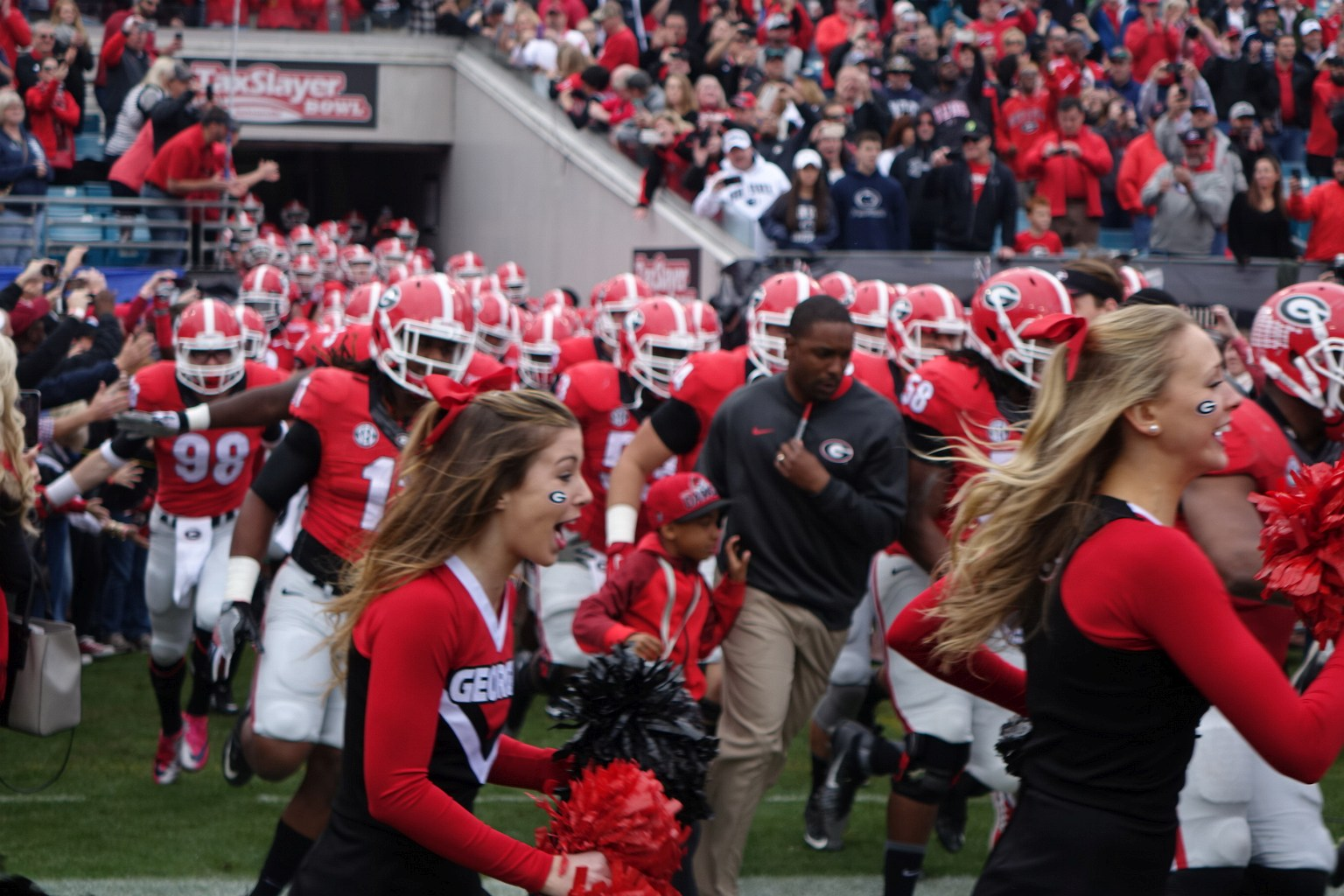 2015 Georgia Bulldogs run out of tunnel for the start of the TaxSlayer Bowl vs. Penn State on 02-JAN-2016 (Photo by Greg Poole)