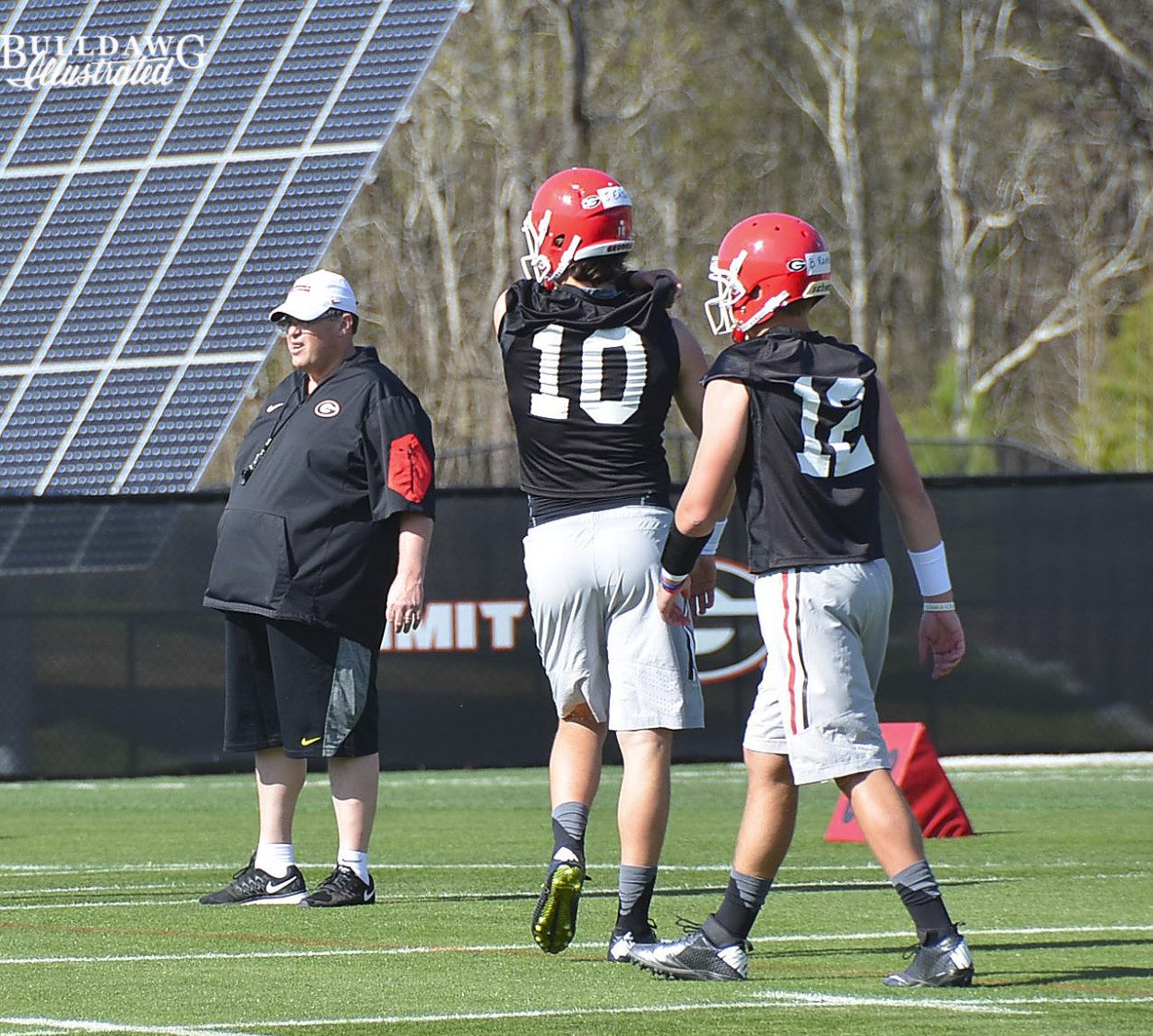 Jacob Eason (10) and Brice Ramsey repping under the gaze of OC Jim Chaney
