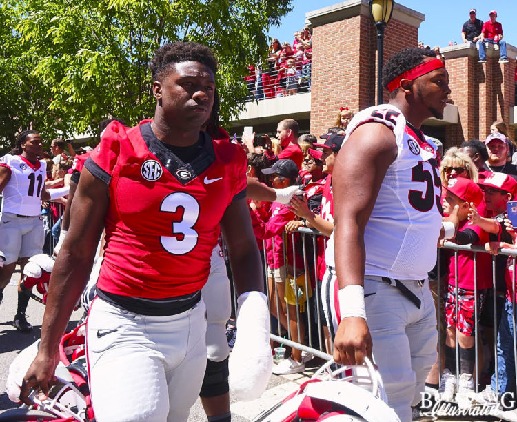 Roquan Smith (3) and Dyshon Sims (55)