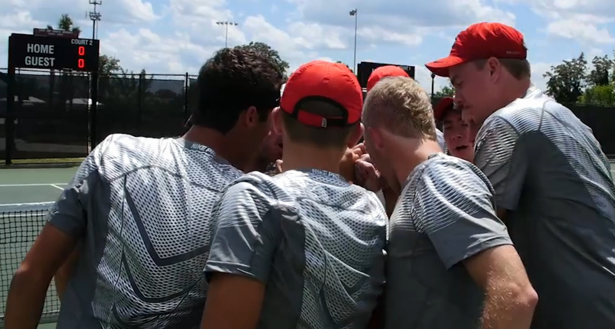 GA men's tennis team huddles up for 2016 SEC tournament semi-final's match (photo is a screen capture of UGA video)