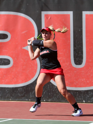 Kennedy Shaffer hits the ball during a singles match during an NCAA match between Georgia and Virginia on Thursday, March 17, 2016, in Athens, Ga. (Photo by Emily Selby)