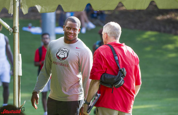 Nick Chubb and Ron Courson chat prior to Kirby Smart camp day 2