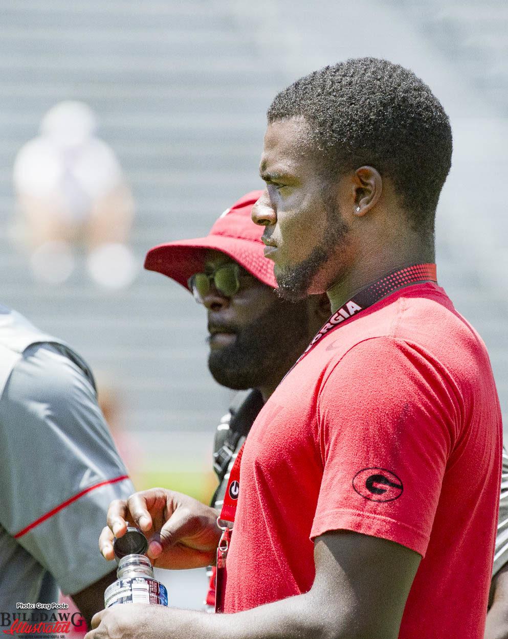 Recruiting prospect Leonard Warner watches warm-ups