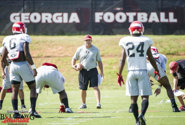 Kirby Smart looks on as the defense goes through drills. Natrez Patrick (6) and Dominick Sanders (24)