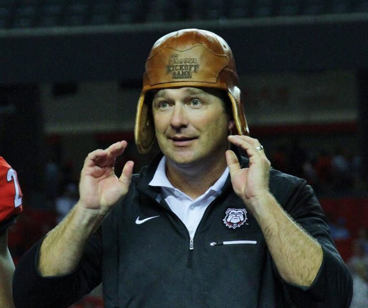 Kirby Smart dons the leather helmet