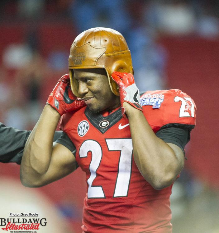 Nick Chubb tries on the leather helmet