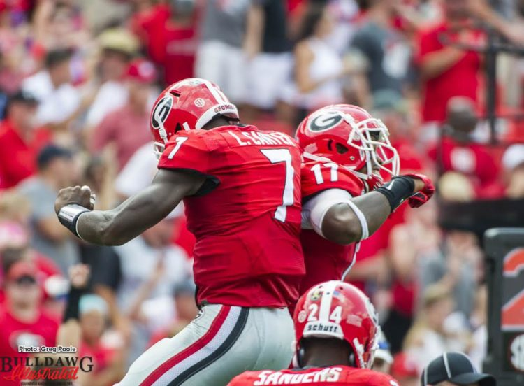 Lorenzo Carter (7) and Davin Bellamy (17)