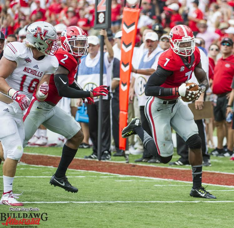 Lorenzo Carter is headed for the end zone with a fumble recovery vs. Nicholls State