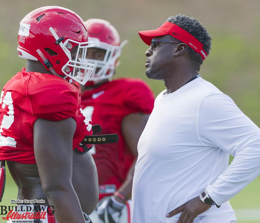 (L-R) Defensive lineman Tyler Clark (52) gets the stare from DL Coach Tracy Rocker