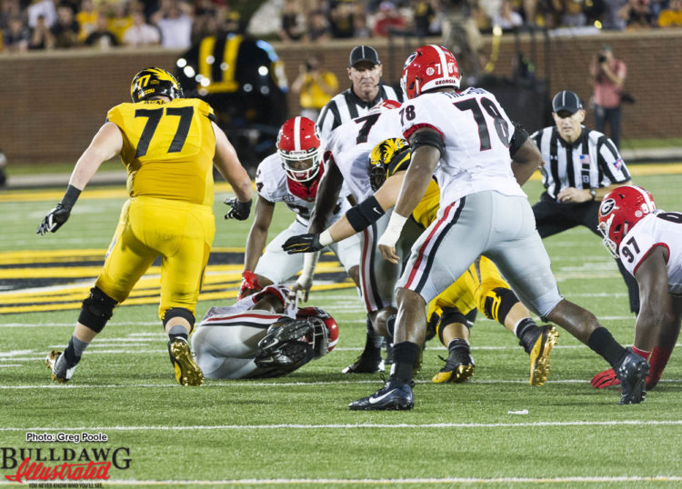 Juwan Briscoe (12) recovers fumble for Dawgs to seal the deal