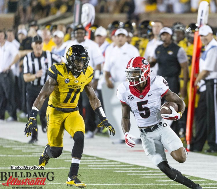 Terry Godwin (5) looking for more yards after the catch
