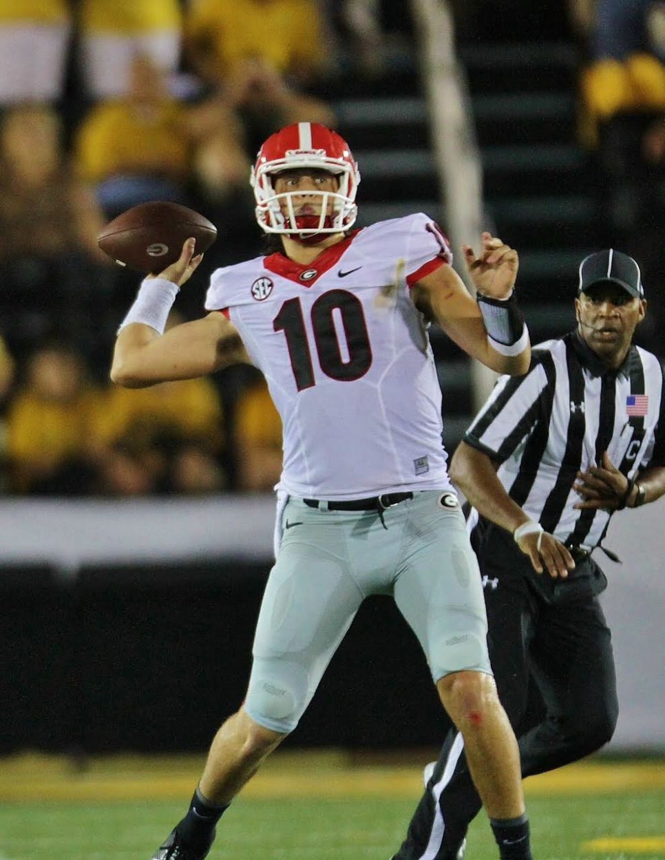 Jacob Eason drops back to complete one of his 55 pass attempts. (photo by Rob Saye)
