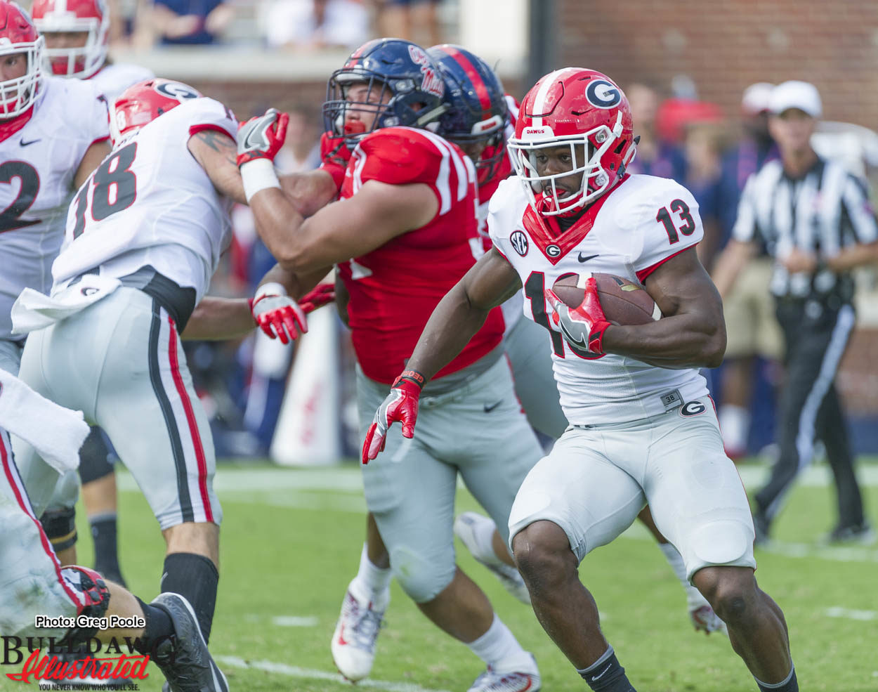 Good to see Elijah Holyfield (13) run the ball, Isaac Nauta (18) sets the edge