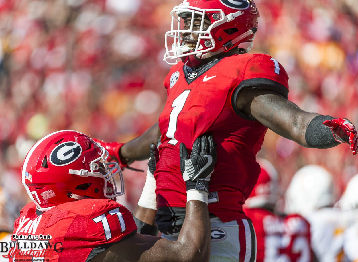 Isaiah Wynn (77) lifts Sony Michel (1) to celebrate a touchdown