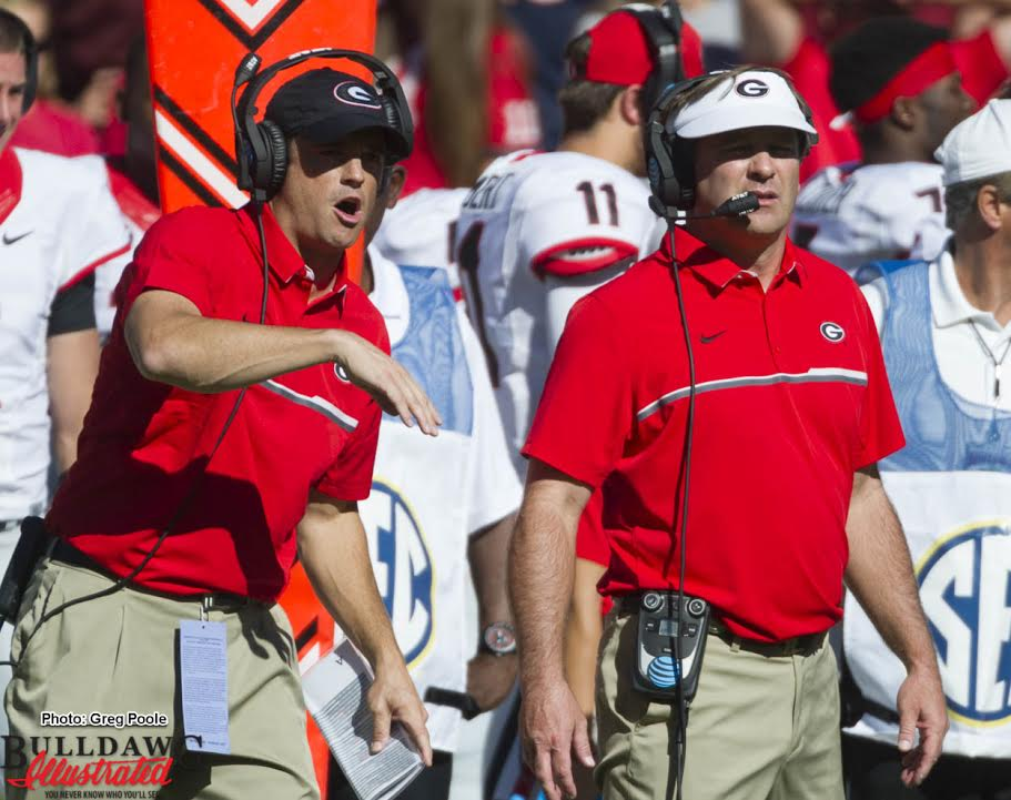 Kirby Smart (on right) looks on as his team battles South Carolina on Sunday afternoon on the way to a 28-14 Bulldog win