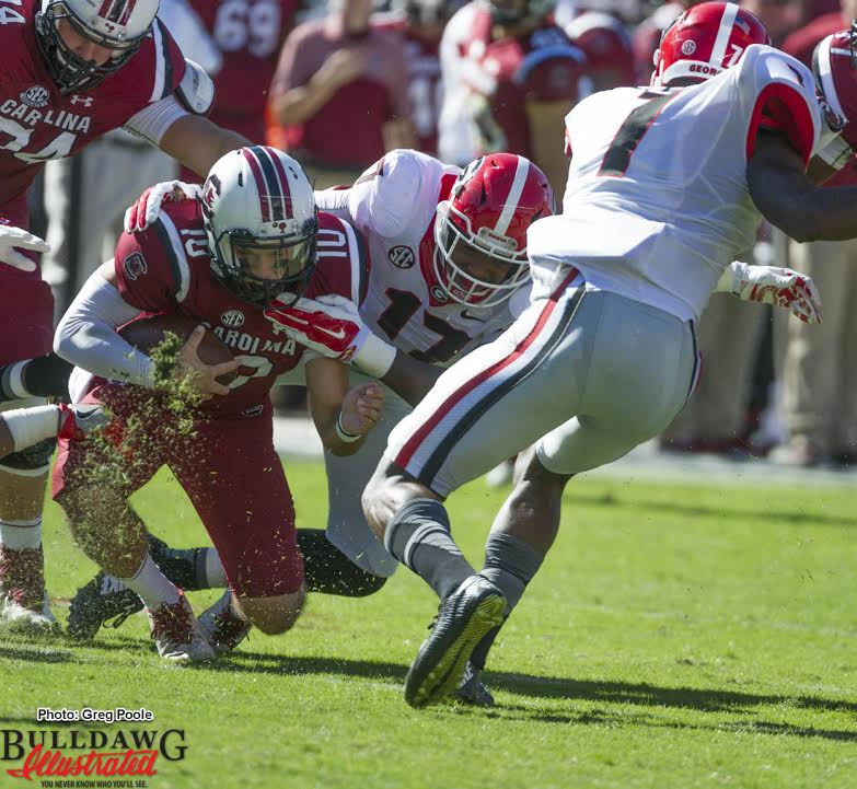 Davin Bellamy (17) drags down SC QB Perry Orth (10) for a sack