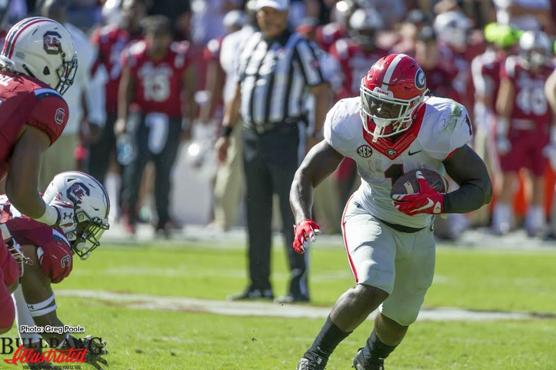Sony Michel (1) running hard on his way to 133 yards on 21 carries