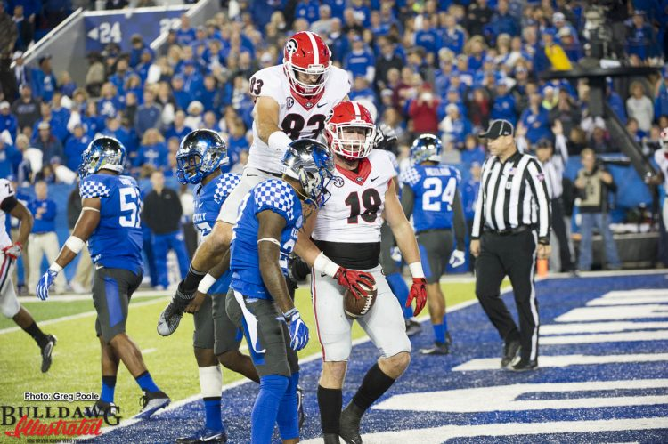 Tight ends Jeb Blazevich (83) and Isaac Nauta (18)