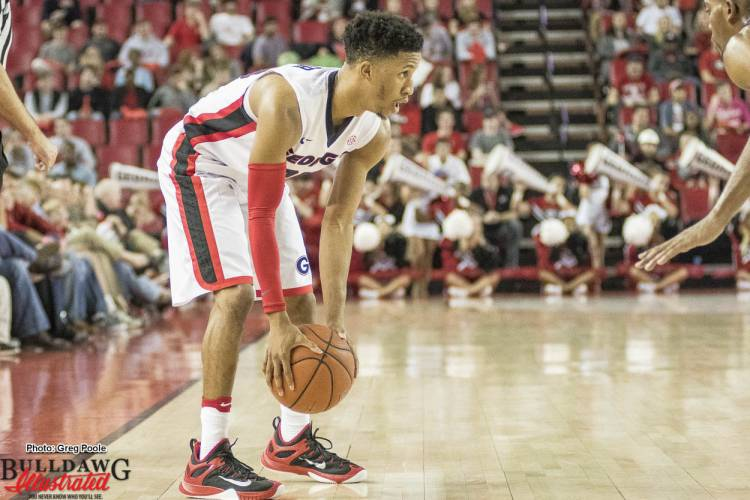 J.J. Frazier(30) analyzes the court before making a decision.