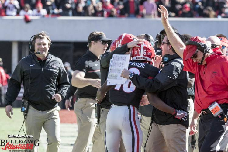 After Isaiah McKenzie (16) returns a punt for a TD, Head Coach Kirby Smart and the staff are all smiles.