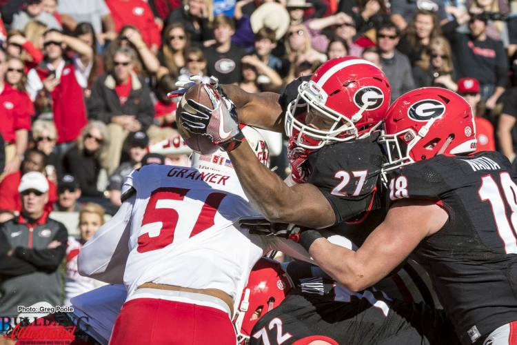 Nick Chubb (27) fights and extends the ball to break the plain of the goal line for a touchdown