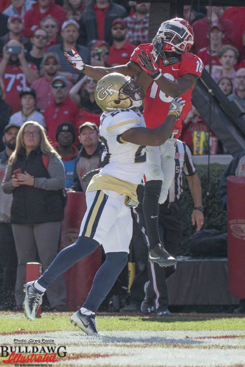 Isaiah McKenzie (16) outjumps the GT defender but is interferred with