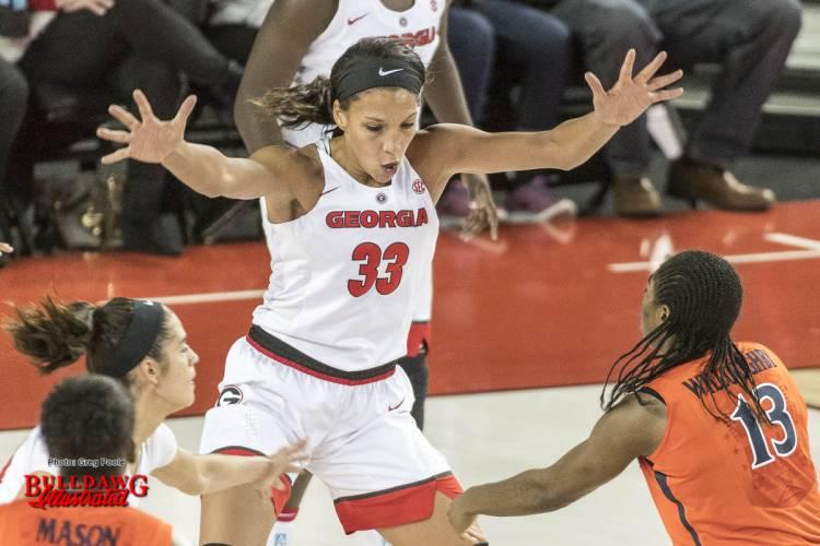 Mackenzie Engram guarding a player for Virginia.