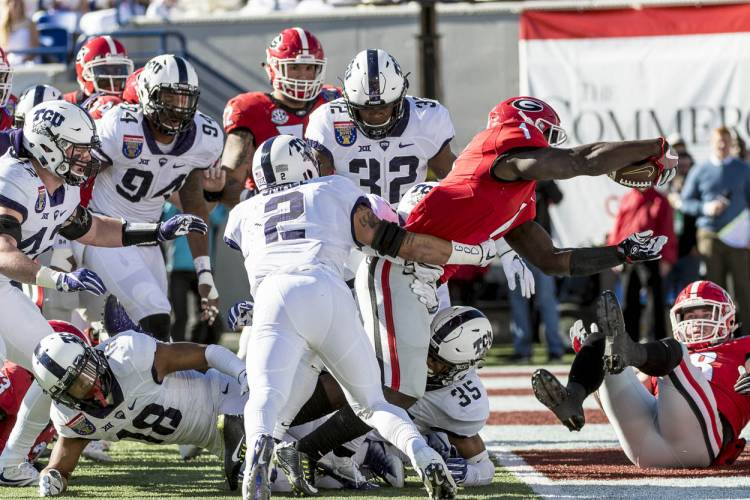 Sony Michel scores opening touchdown of the Liberty Bowl.