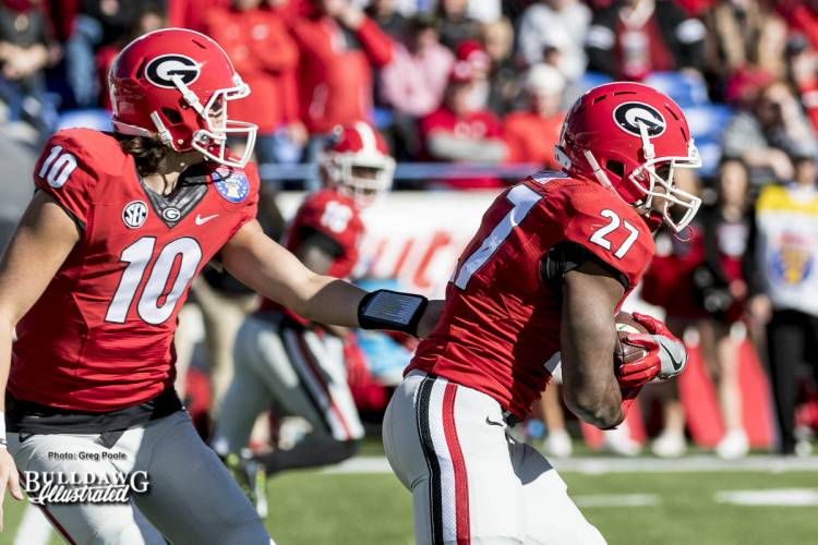 Jacob Eason (10) hands the ball off to Nick Chubb (27) during the Liberty Bowl.