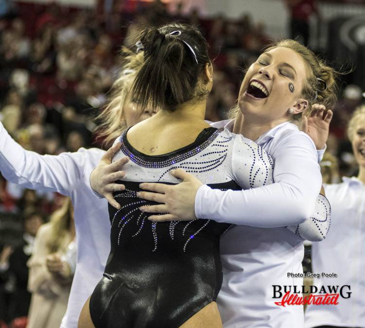 The Gymdogs celebrate an impressive routine.