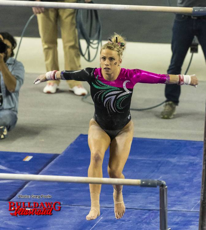Morgan Reynolds eyes the bars to begin her routine.
