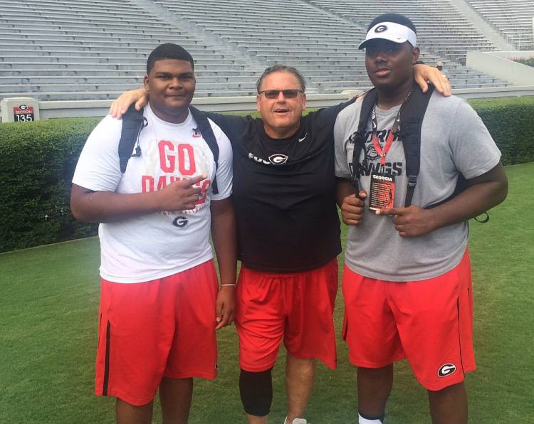Jamaree Salyer (left) and Andrew Thomas (right) with Georgia OL Coach Sam Pittman (photo from Jamaree Salyer - Twitter)