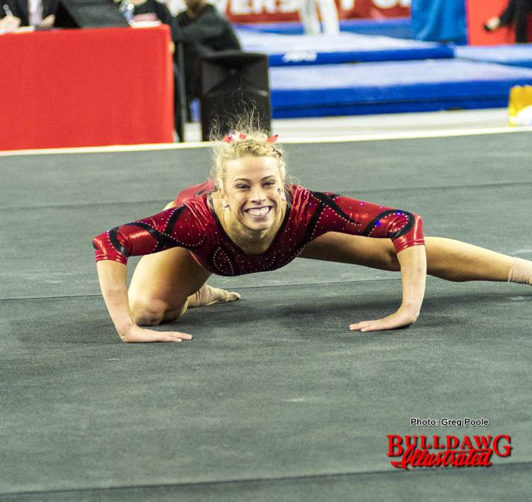 Morgan Reynolds smiles for the camera during her floor performance.