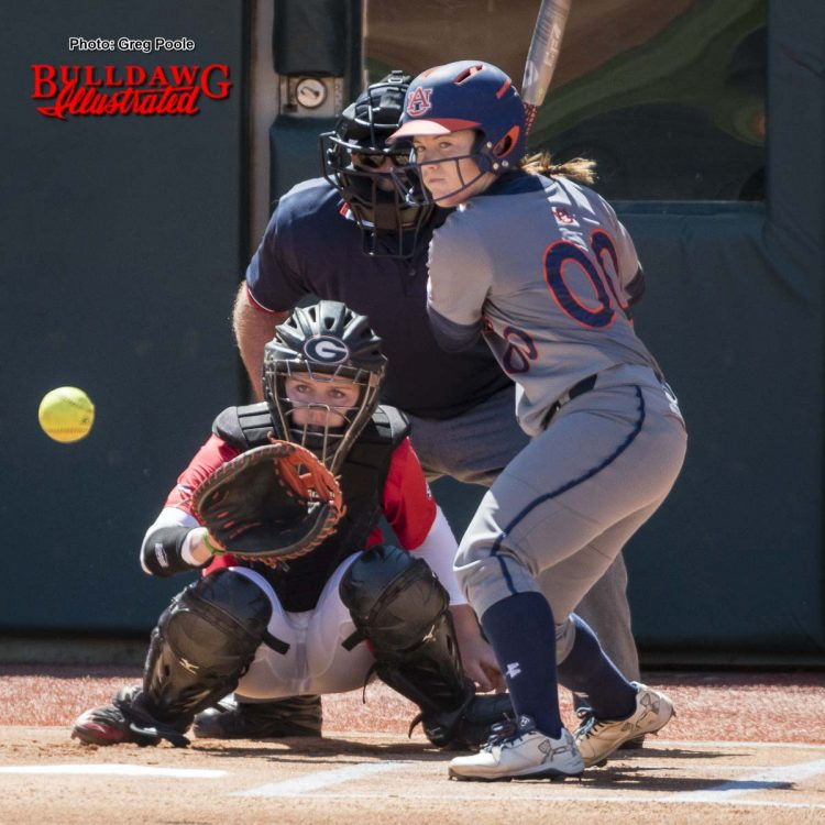Catcher Maeve McGuire looks the ball in to her mitt