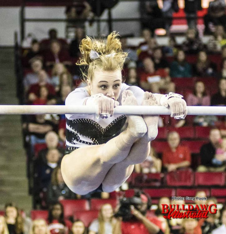 Hayley Sanders eyes the other bar during her routine.