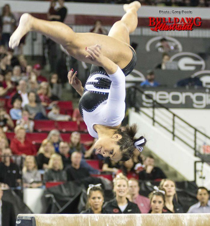 Sabrina Vega eyes the beam to stay balanced.