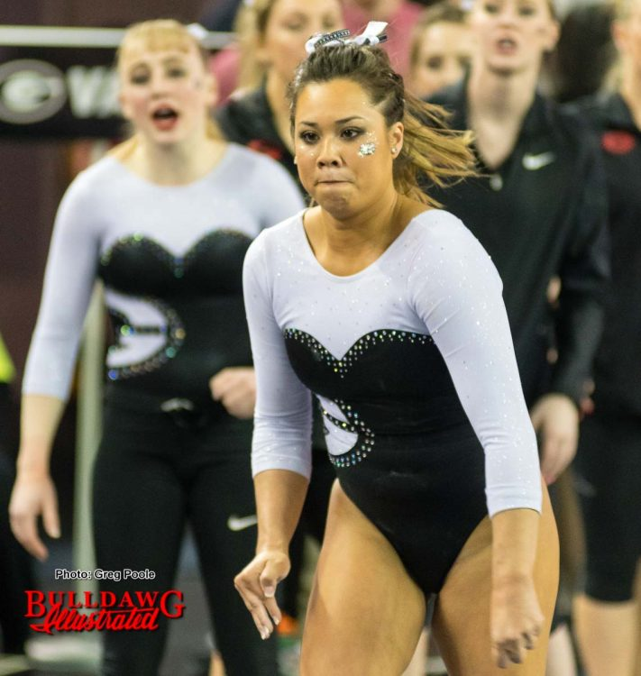 Ashlyn Broussard eyes the vault as she runs down the vault runway.