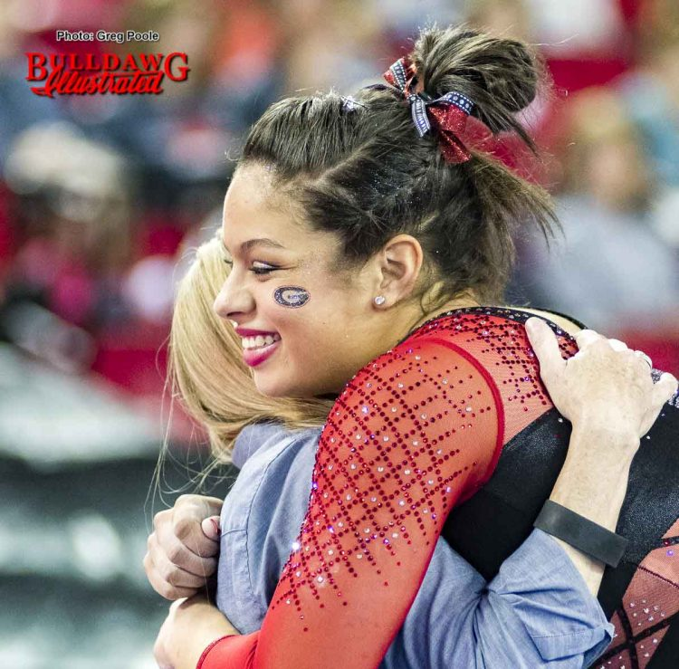 Sabrina Vega hugs  coach Danna Durante